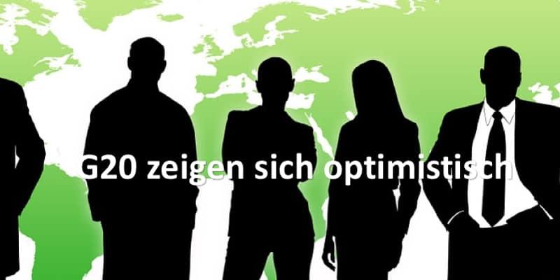 Geschäftsleute stehen vor Weltkarte